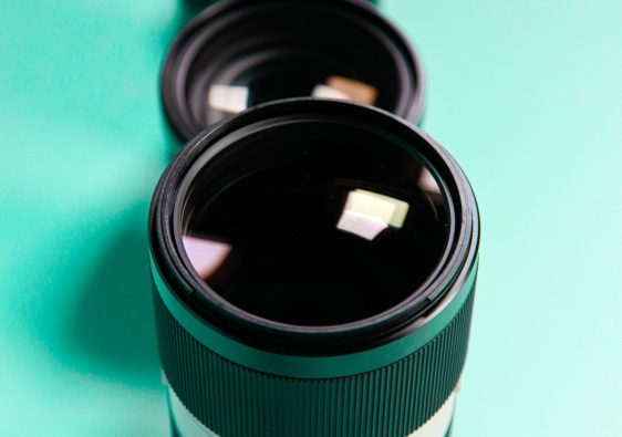 3 Lenses lined vertically on a teal background- 3 lenses you need feature image