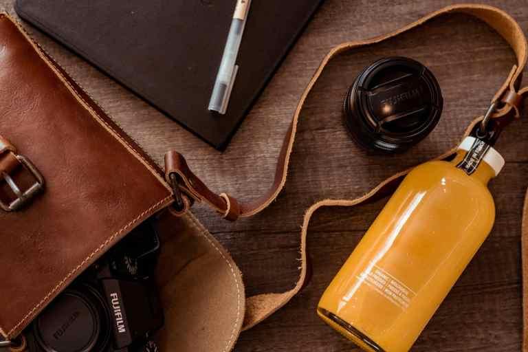Camera bag carrying a Fuji Film lens and camera