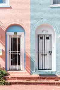 One half pink wall with blue window, the other half blue wall with white window -Quarantine Feature Image