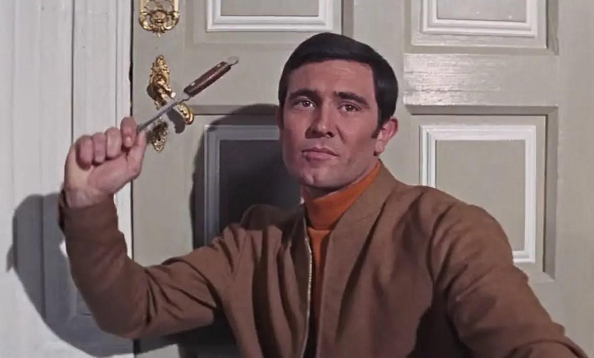 Timothy Dalton as James Bond wearing brown Golf Attire in On Her Majesty's Secret Service
