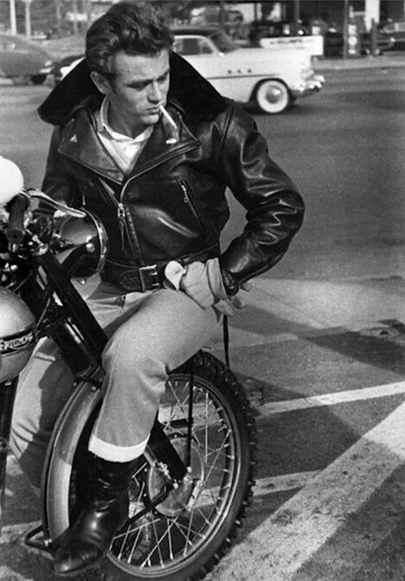 James Dean, riding a 1955 Triumph Trophy and wearing a leather jacket in the film Rebel Without a Cause
