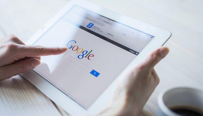 """alt=""""Woman Uses Google Engine on Tablet"""""""