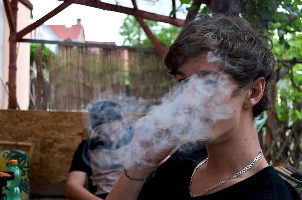 A boy smoking pot
