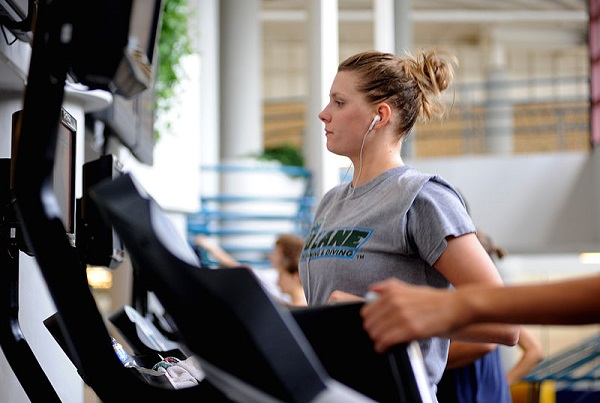Young woman working out on the treadmill