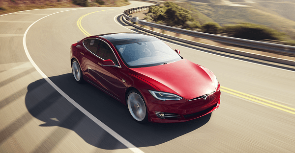 Red Tesla Model S on the road