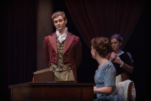 Gregory Maheu as Fitzwilliam Darcy begins to flirt with Elizabeth as Jane Austen watches (photo credit: Ron Heerkens Jr./broadwayworld.com)