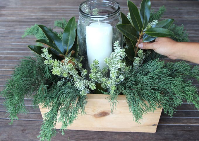 DIY Christmas Table Decorations  Easy Centerpiece in 10 minutes   A     The silvery Hebe branches look gorgeous against the blue green Cypress and  huge deep green Magnolia leaves