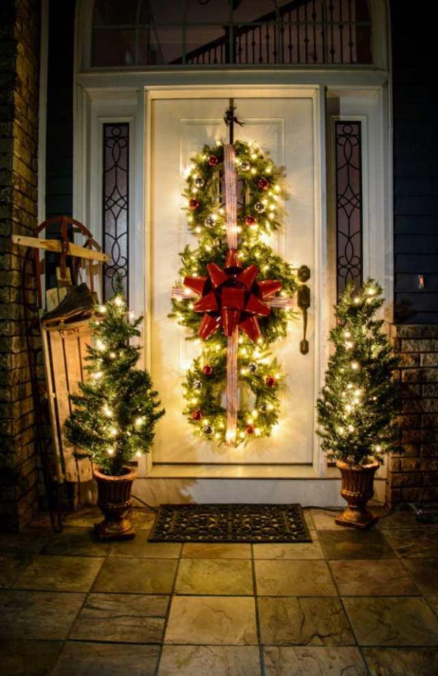 DIY outdoor christmas decorations ideas porch decor lights front door wreath garland large ornaments farmhouse wood sign lanterns apieceofrainbow 17