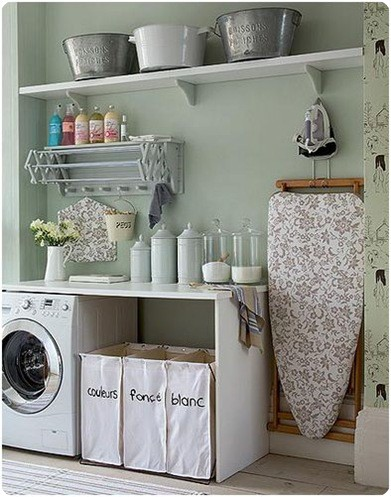 laundry room with folding table and pull out drying rack