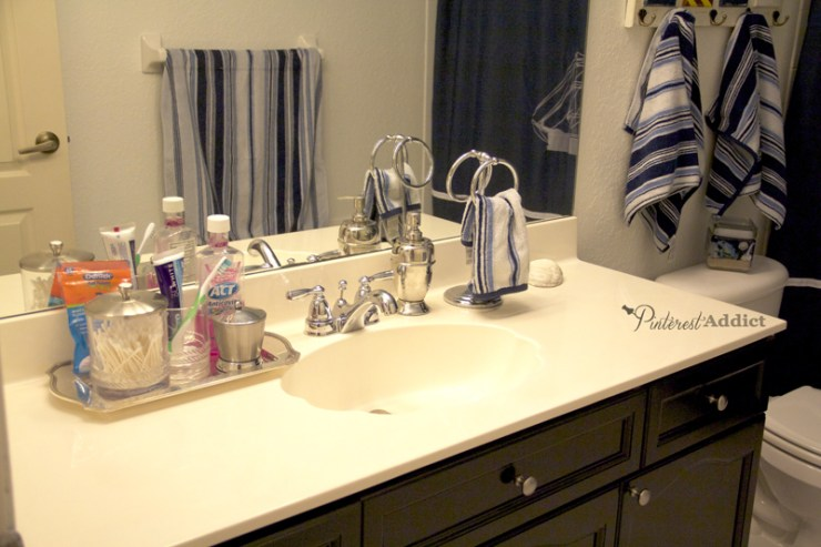 nautical bathroom counter with silver tray
