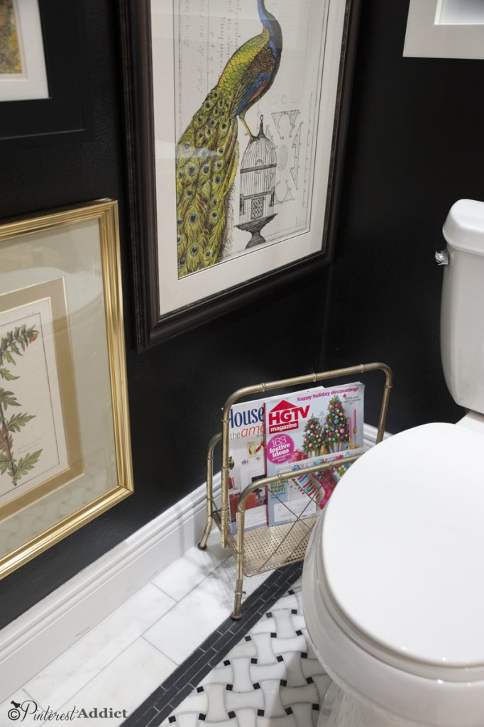 Brass faux bamboo magazine rack in the Art Gallery Bathroom