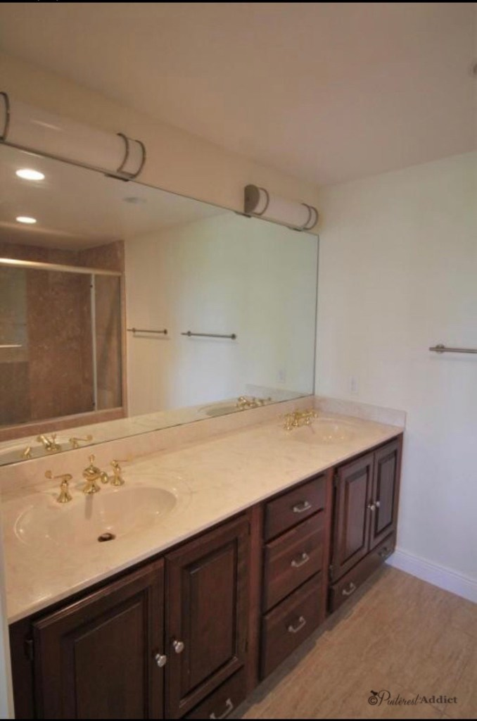 dated bathroom cabinets with gold fixtures