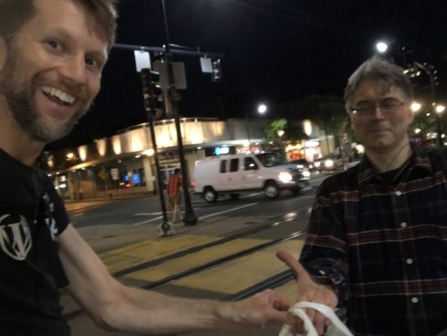 Paul handing Ken a bag of disks