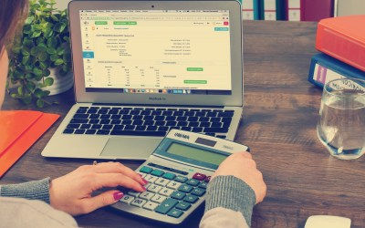 Laptop & Calculator - Three Financial Reports Every Nonprofit Needs