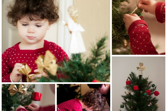 Toddler decorating a Christmas Tree
