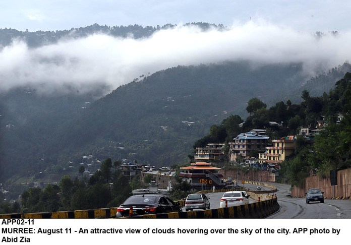 MURREE: August 11 - An attractive view of clouds hovering over the sky of the city. APP photo by Abid Zia