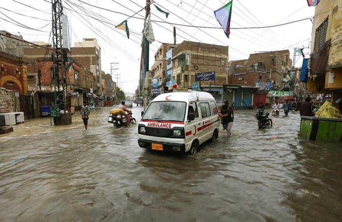 HYDERABAD: August 31 – A view of rain water accumulated at Goods Naka Road due to heavy rain in the city. APP photo by Akram Ali