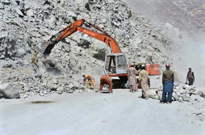 GILGIT: August 22 - FWO workers busy in construction work of Skadu-Gilgit Road. APP photo by Ashraf Hussain Nasiri