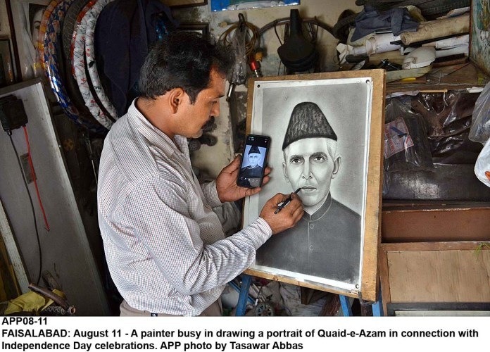 FAISALABAD: August 11 - A painter busy in drawing a portrait of Quaid-e-Azam in connection with Independence Day celebrations. APP photo by Tasawar Abbas
