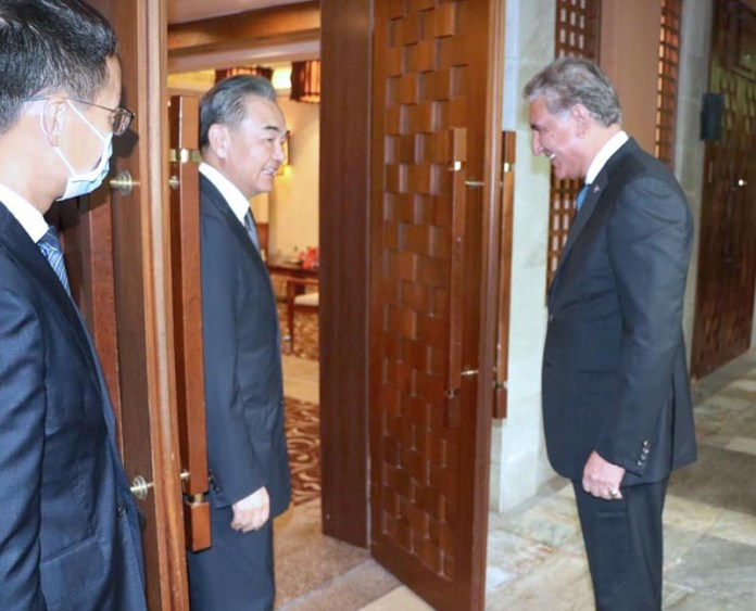 HAINAN: August 21 - Chinese State Councilor and Foreign Minister Wang Yi warmly receives Federal Minister for Foreign Affairs, Makhdoom Shah Mahmood Qureshi at Hainan Province of China. APP