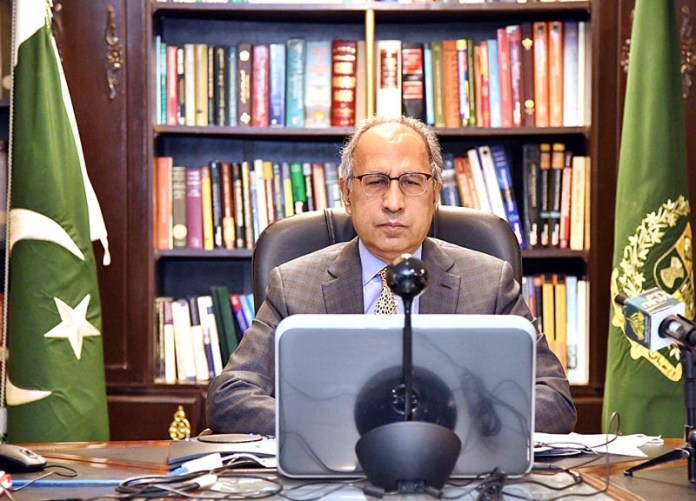 "ISLAMABAD: August 31 - Adviser to the Prime Minister on Finance and Revenue, Dr. Abdul Hafeez Shaikh addressing through video link at a high-level event ""Financing for development in the era of Covid-19 & Beyond"