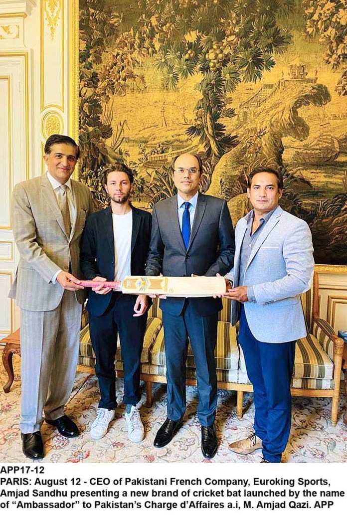 "PARIS: August 12 - CEO of Pakistani French Company, Euroking Sports, Amjad Sandhu presenting a new brand of cricket bat launched by the name of ""Ambassador"" to Pakistan's Charge d'Affaires a.i, M. Amjad Qazi. APP"