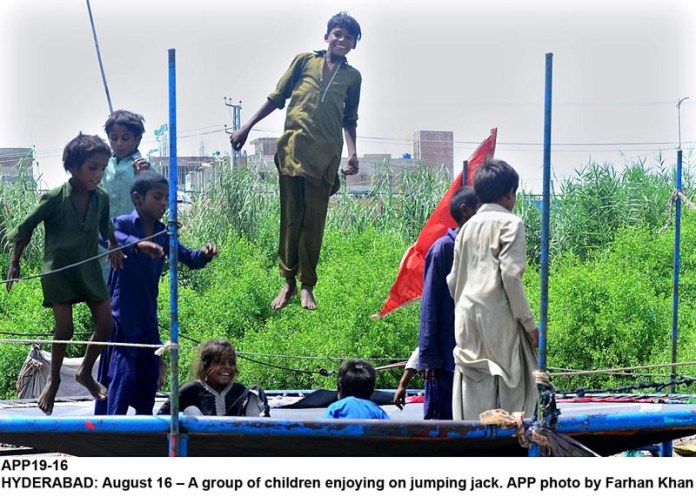 HYDERABAD: August 16 – A group of children enjoying on jumping jack. APP photo by Farhan Khan