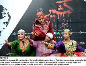 KARACHI: August 15 - Activists of Human Rights Commission of Pakistan presenting a street play to mark India's Independence Day as Black Day against Human rights violation, military siege and atrocities in Occupied Kashmir outside Press Club. APP Photo by Saeed Qureshi