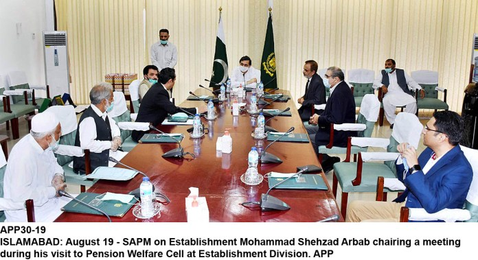 ISLAMABAD: August 19 - SAPM on Establishment Mohammad Shehzad Arbab chairing a meeting during his visit to Pension Welfare Cell at Establishment Division. APP