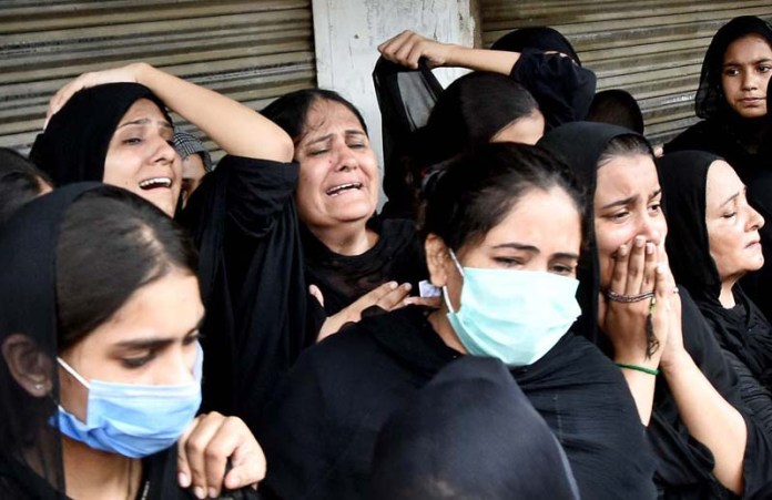 LAHORE: August 30 - A large number of women attending the procession of Youm-e-Ashura, the 10th day of Muharram-ul-Harram. Aashura marks the death anniversary of Imam Hussain ibn Ali (AS), (the grandson of Prophet Mohammad (PBUH)) a 7th century revolutionary leader who was martyred in the battle of Karbala. The day of Ashura is recognised by millions across the world to remember Imam Hussain's dignified stand for social justice. APP photo by Mustafa Lashari
