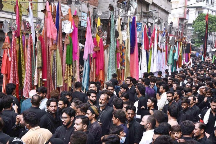 LAHORE: August 29 - A large number of mourners attending the procession on 9th of the Holy Month of Muharram-ul-Haram. Muharramul Harram known as the first month of the Islamic calendar and the mourning month in remembrance of the martyrdom (Shahadat) of Hazrat Imam Hussain (AS), the grandson of the Holy Prophet Mohammad (SAWW).APP Photo by Mustafa Lashari