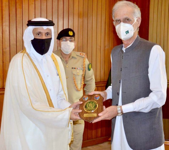 ISLAMABAD: August 24 - Federal Minister for Defence, Pervez Khattak presenting a shield to H.E. Sheikh Saoud bin Abdulrahman Al Thani, Ambassador of Qatar. APP