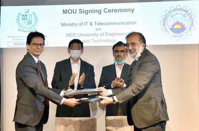 KARACHI: August 24 - Federal Minister for IT and Telecommunication Syed Amin Ul Haque witnessing during the MoU signing ceremony between Ministry for IT and Telecommunication & (NED University of Engineering & Technology at NIC Karachi (NED University Campus). APP