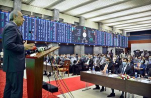KARACHI: September 07 - Advisor to Prime Minister on Finance & Revenue Dr Abdul Hafeez Shaikh addresses during a ceremony on listing of Pakistan Holding Limited's Pakistan Energy Sukkuk II, at the trading hall in Pakistan Stocks Exchange. APP photo M. Saeed Qureshi