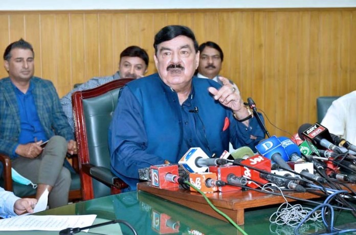 LAHORE: September 26 - Federal Minister for Railways Sheikh Rashid Ahmed addressing a press conference at Railway Headquarters. APP photo by Ashraf Ch