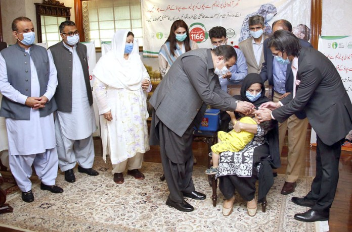 LAHORE: September 21 - CM Punjab Usman Buzdar is giving Anti-Polio drop to a child to launch the campaign. APP photo by Amir khan
