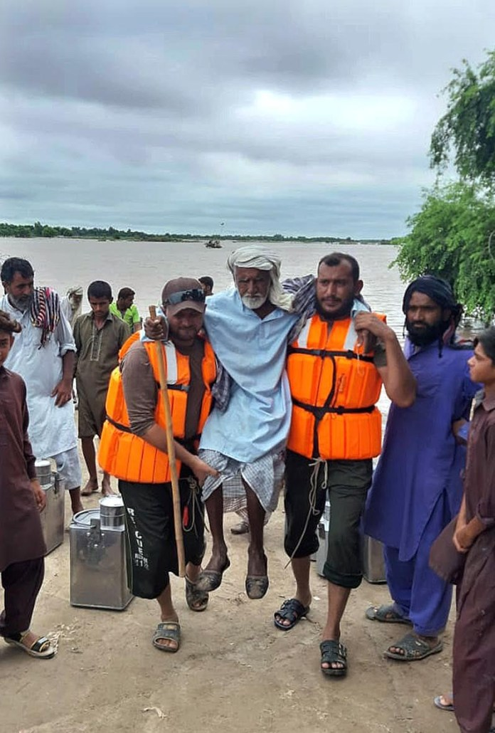 MULTAN: September 02 - Rescue 1122 busy in evacuating flood affected people at Muhammad Pur Ghota. APP