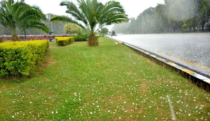 ISLAMABAD: September 25 – A view of hailstorm and rain as the weather changes after a long spell of hot weather in the federal capital. APP photo by Saadia Haidari