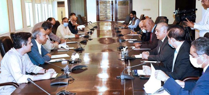 ISLAMABAD: September 11 - Adviser to the Prime Minister on Finance and Revenue, Dr. Abdul Hafeez Shaikh in a meeting with Chairman, FMPAC and MD, Fauji Fertilizer Company. APP