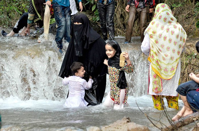 ISLAMABAD: September 16 - Families enjoying in water stream at Trail-5 of Margala Hills. APP Photo by Irshad Sheikh