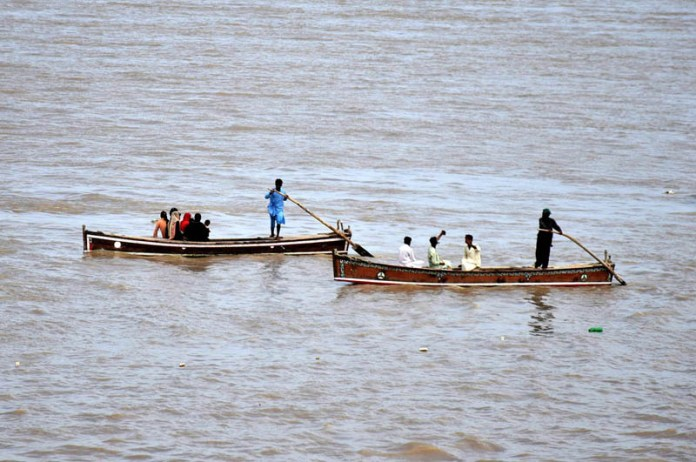 HYDERABAD: September 18 – People enjoying boat ridding at Indus River. APP photo by Akram Ali