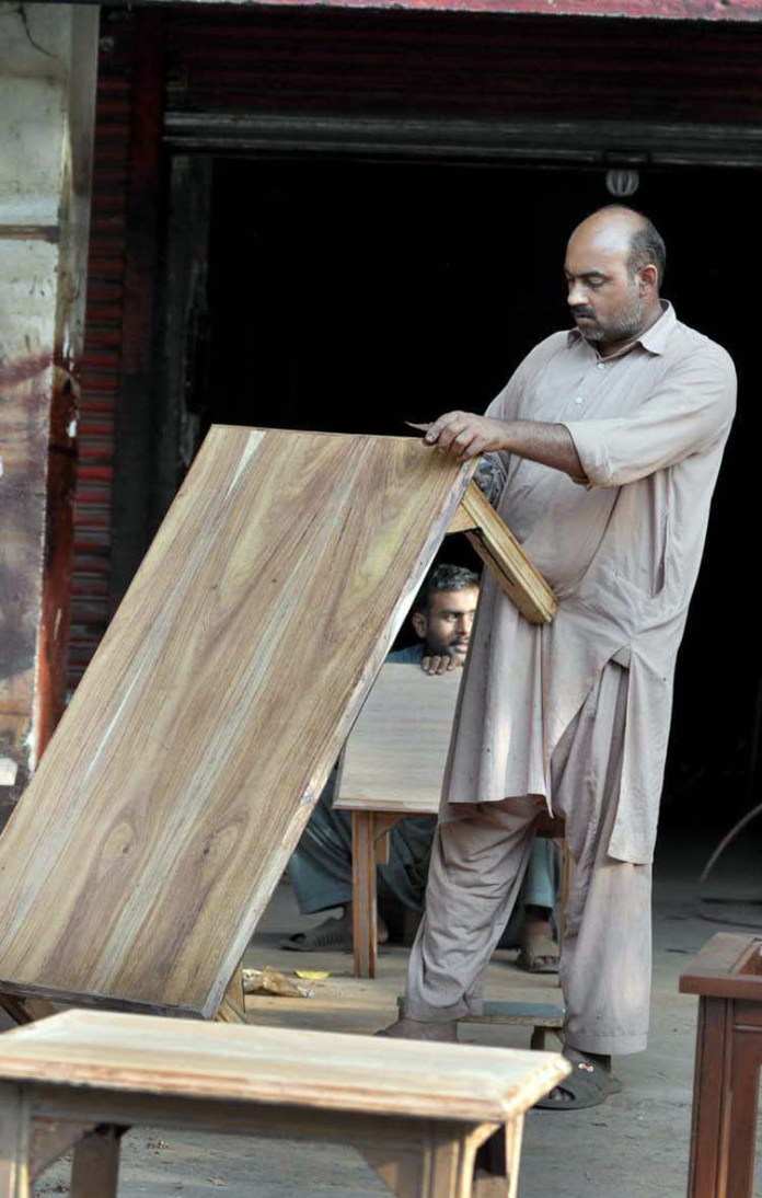 ISLAMABAD: September 29 - A carpenter preparing wooden furniture at his workplace at G-7 market. APP photo by Irshad Sheikh