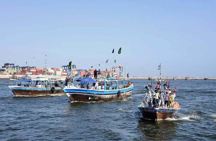 KARACHI: September 08 - Local fishermen participating in a boat rally organized by Pakistan Navy in connection with Navy Day celebrations. APP