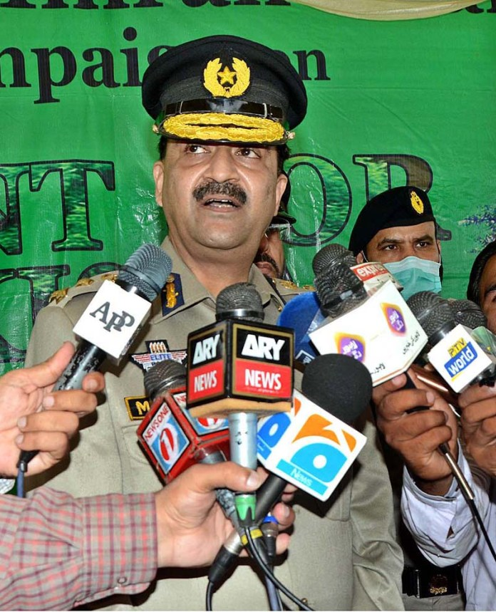 LAHORE: September 01 - DIG Motorway Police Mehboob Aslam Lillah talking to media persons during Prime Minister Clean and Green Pakistan Campaign. APP Photo by Ashraf Ch