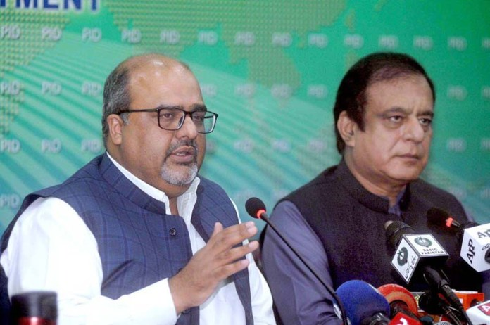 ISLAMABAD: September 19 – Federal Minister for Information and Broadcasting Senator Shibli Faraz and Advisor to PM on Interior Shahzad Akbar jointly addressing a press conference at PID Media Centre. APP photo by Irfan Mahmood