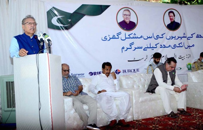 SANGHAR: September 12 – President Dr. Arif Alvi addressing after distributing ration bags among the rain affected people arranged by Sheikh Khalifa Bin Zayed Al Nahiyan Foundation at Jam Zulfiqar Ali Khan at Goht Jam Nawaz Ali. APP photo by Farhan Khan