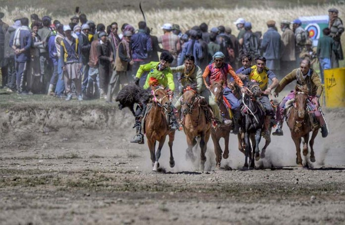 BROGHIL: September 14 – Players participating in traditional game during Broghil Festival. APP