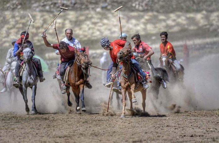 BROGHIL: September 14 – Players participating in polo match during Broghil Festival. APP