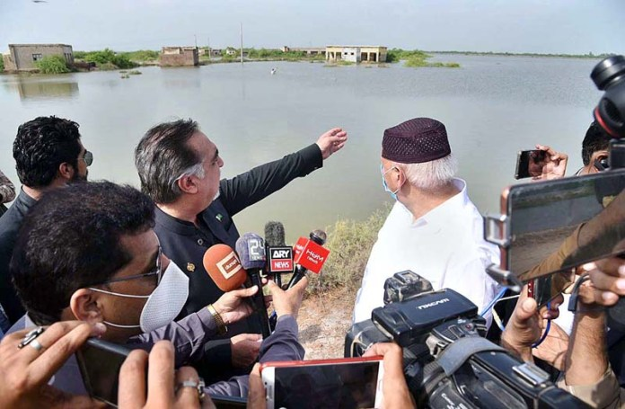 BADIN: September 02 – Punjab Governor Chaudhry Muhammad Sarwar along with Sindh Governor Imran Ismail visiting rain affected areas. APP photo by Akram Ali