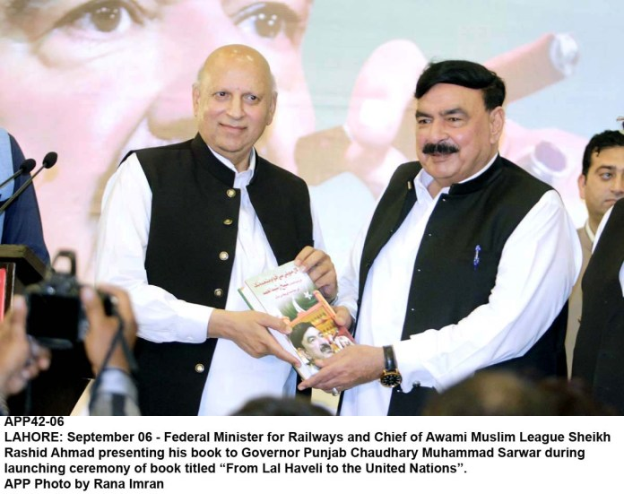 "LAHORE: September 06 - Federal Minister for Railways and Chief of Awami Muslim League Sheikh Rashid Ahmad presenting his book to Governor Punjab Chaudhary Muhammad Sarwar during launching ceremony of book titled ""From Lal Haveli to the United Nations"". APP Photo by Rana Imran"